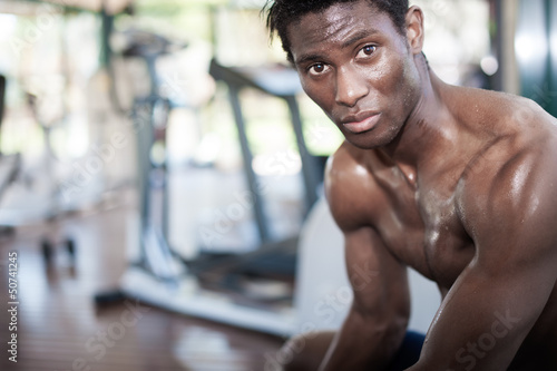 muscled black athlete looking at camera