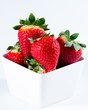 Diet, fresh strawberries in white bowl