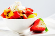 Diet, muesli with strawberries and fruit salad
