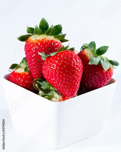 Diet, fresh strawberries in white bowl