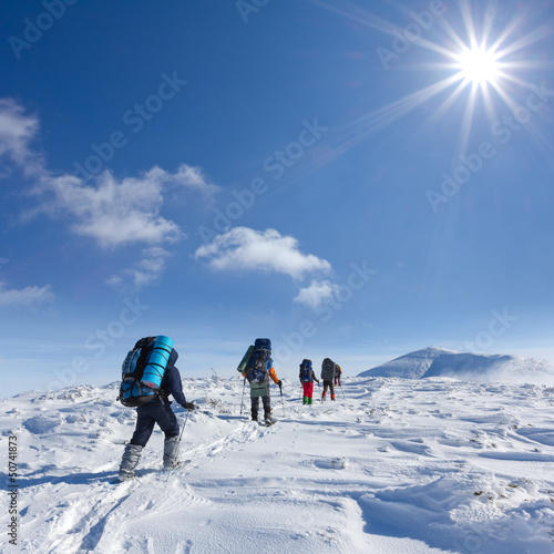 group of tourists in a winter mountains