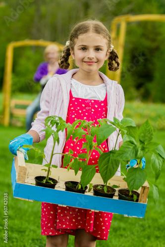 Gardening, planting - lovely girl working in vegetable garden