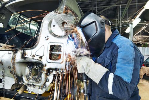 Leinwandbild Motiv repairman welding metal body car