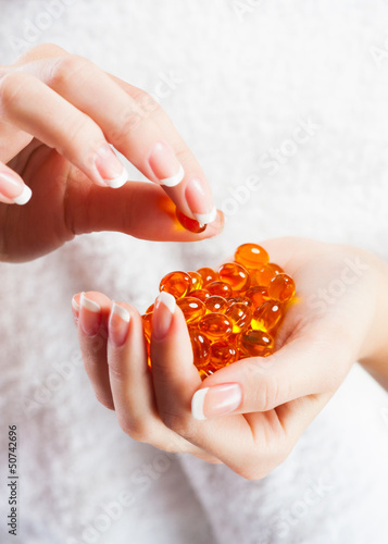 Woman hands with pillls
