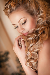 Beautiful blonde woman with hairstyle and make-up