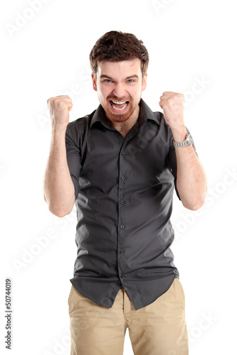 Excited handsome business man with arms raised in success