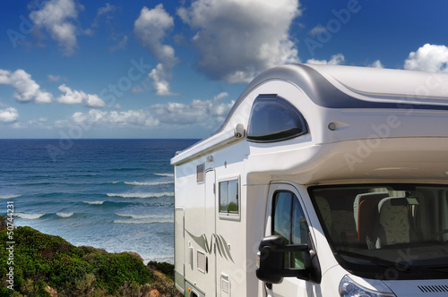 Camper parked on the beach at Buggerru, Sardinia, Italy