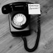 Black retro telephone with reminder note to remember a birthday