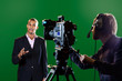 Presenter in studio with TV camera and Camera Operator - 50745455