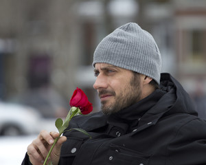 tough man with red rose