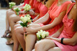 Row of bridesmaids with bouquets