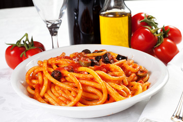 pasta with olives, bacon and sauce