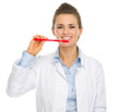 Smiling dental doctor woman showing how to clean teeth