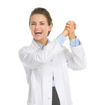 Happy woman in white robe rejoicing success