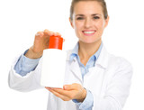 Smiling cosmetologist woman showing sun block creme poster