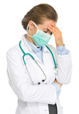 Frustrated medical doctor woman in mask