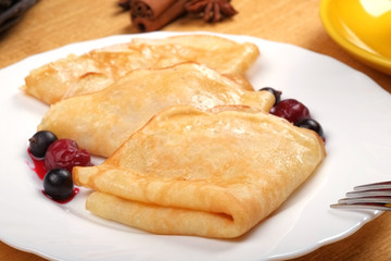 Fried pancake with cherries
