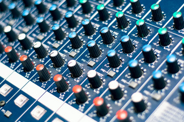 Music mixer in studio, close-up of audio controls