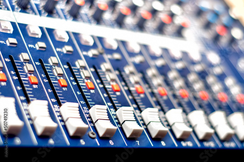 Close-up of music mixer in audio studio, ready for party
