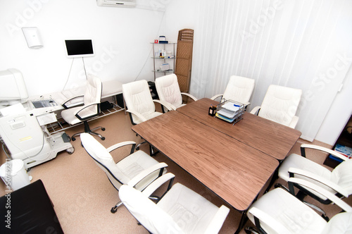 Medical office with ultrasound equipment and conference table