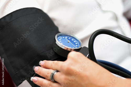 taking an arterial blood pressure with a tonometer