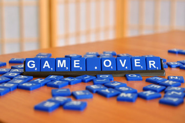 closeup to scrapble word to game over
