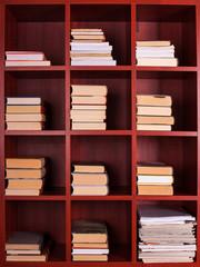 Books on a brown shelf