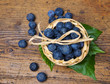 blueberries in a little basket on a table