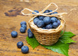 fresh blueberries in a little basket on a table