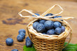 fresh blueberries in a little basket on a table in detail