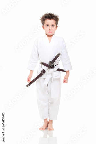 Little funny boy in kimono with swords
