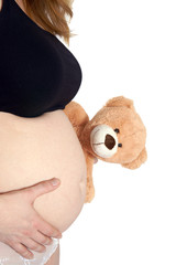 pregnant woman with bare belly and Teddy Bear