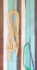 Rope and tools hang on wooden board
