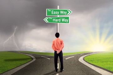 Businessman choose easy or hard way