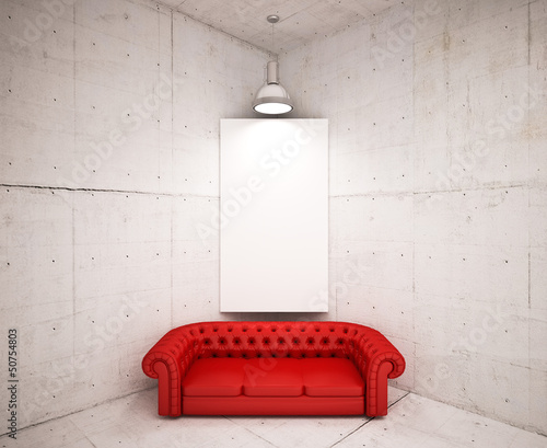 banner on wall with  red sofa