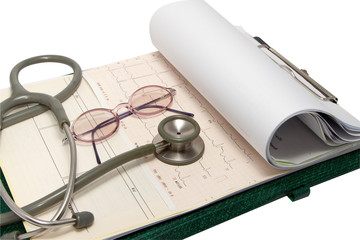 Stethoscope and glasses on electrocardiogram chart