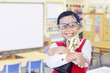 Boy holds trophy at school