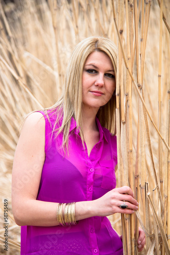 Blonde Girl With Pink Shirt In Reed