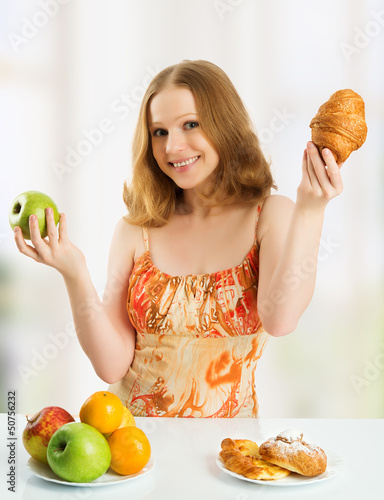 woman  choose between healthy and unhealthy food