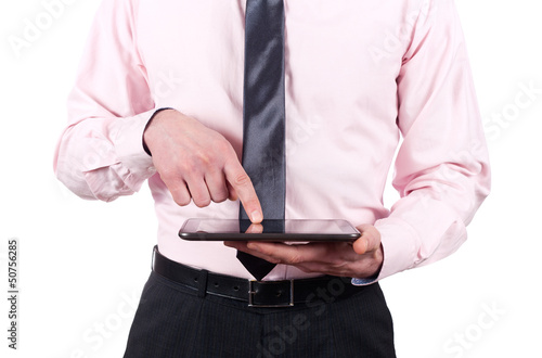 Young man working on a digital tablet isolated on white backgrou