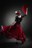 Fototapety young woman dancing flamenco on black