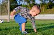 Cute little boy on a soccer field