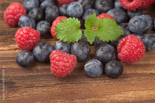 Blueberries with raspberries on wood IV