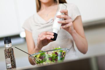 Woman preparing a salad at home