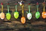 Colorful Easter eggs on a fun clothespins.