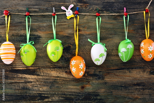 Colorful Easter eggs on a fun clothespins. - 50759888