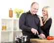 Affectionate couple preparing dinner