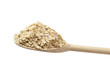 Oat flake on the wooden spoon