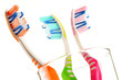 Composition with toothbrushes isolated on white