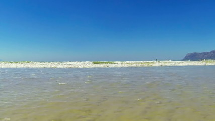 Small ocean waves running into camera